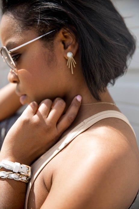 Camille K in Bebe Wrap Bracelet and Jackie Spike Earrings.